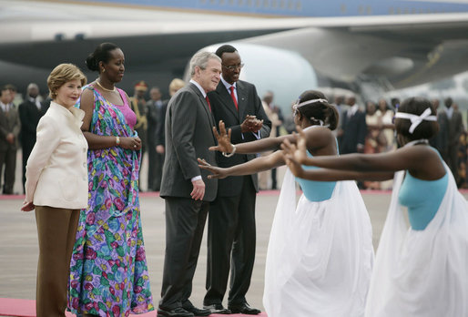 President George W. Bush and Mrs. Laura Bush are welcomed Tuesday, Feb. 19, 2008 by Rwanda President Paul Kagame and his wife, Jeannette Kagame, on their arrival to Kigali International Airport in Kigali, Rwanda. White House photo by Shealah Craighead