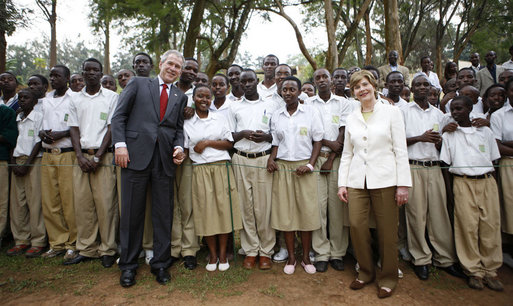 President George W. Bush and Mrs. Laura Bush pose for a photo with the Lycee de Kigali students Tuesday, Feb. 19, 2008 in Kigali, Rwanda. White House photo by Eric Draper