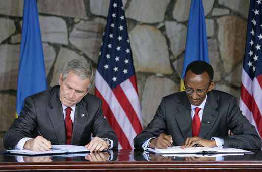 President George W. Bush and Rwanda President Paul Kagame sign a Bilateral Investment Treaty Tuesday, Feb. 19, 2008, at the Presidency in Kigali, Rwanda. White House photo by Chris Greenberg