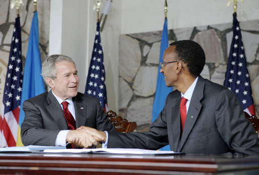 President George W. Bush and Rwanda President Paul Kagame shake hands after signing a Bilateral Investment Treaty Tuesday, Feb. 19, 2008, at the Presidency in Kigali, Rwanda. White House photo by Shealah Craighead