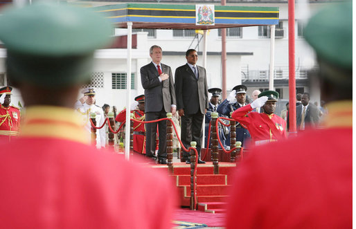 President George W. Bush stands with Tanzania President Jakaya Kikwete during farewell ceremonies Tuesday, Feb. 19, 2008, at the Julius Nyerere International Airport in Dar es Salaam, Tanzania. White House photo by Chris Greenberg