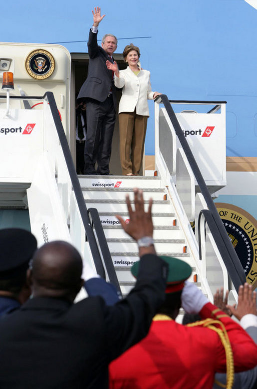 President George W. Bush and Mrs. Laura Bush wave from the steps of Air Force One Feb. 19, 2008, as they depart from Julius Nyerere International Airport in Dar es Salaam, Tanzania. The President and Mrs. Bush are on their way to Rwanda, the third stop of their five-nation tour. White House photo by Chris Greenberg