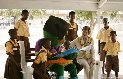 "Mrs. Laura Bush participates in a reading lesson with students in their ""reading hut"" with the school's reading mascot Wednesday, Feb. 20, 2008, at the Mallam D/A Primary School in Accra, Ghana. White House photo by Shealah Craighead"