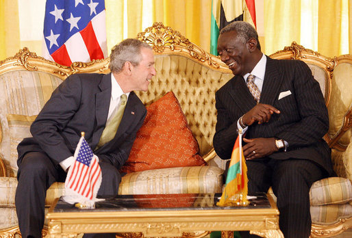 President George W. Bush speaks with Ghana President John Agyekum Kufuor during their meeting at Osu Castle, Wednesday, Feb. 20, 2008 in Accra, Ghana. White House photo by Eric Draper
