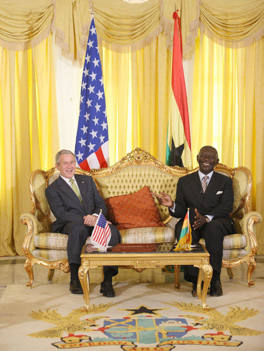 President George W. Bush and Ghana President John Agyekum Kufuor laugh together during their meeting at Osu Castle, Wednesday, Feb. 20, 2008 in Accra, Ghana. White House photo by Eric Draper