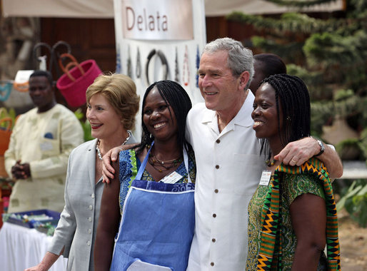 President George W. Bush and Mrs. Laura Bush pose for a photo with two women Wednesday, Feb. 20, 2008, during his visit to the International Trade Fair Center in Accra, Ghana. White House photo by Eric Draper