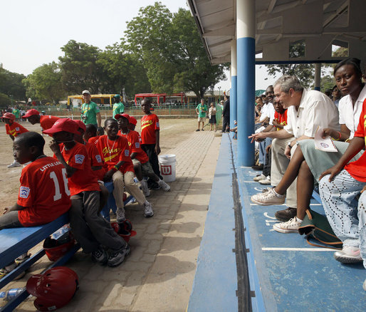President George W. Bush talks with players during a tee ball game Wednesday, Feb. 20, 2008, at the Ghana International School in Accra, Ghana. White House photo by Eric Draper
