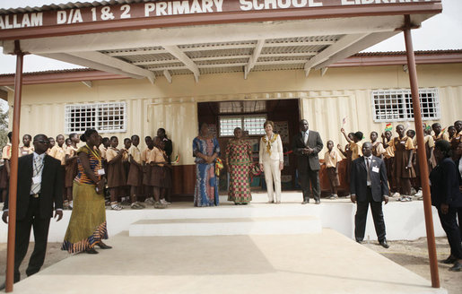 Mrs. Laura Bush and Ghana first lady Mrs. Theresa Kufuor are greeted by students and school officials on their arrival to Mallam D/A Primary School, Wednesday, Feb. 20, 2008 in Accra, Ghana. White House photo by Shealah Craighead