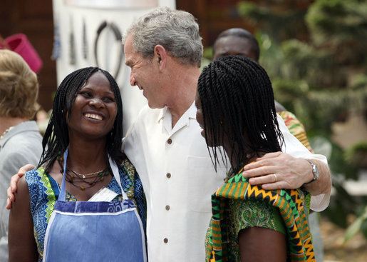President George W. Bush talks with two women Wednesday, Feb. 20, 2008, during his visit to the International Trade Fair Center in Accra, Ghana. White House photo by Eric Draper