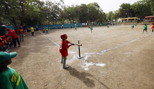 Kids play a tee ball game during the President's visit Wednesday, Feb, 20 2008, at the Ghana International School in Accra, Ghana. White House photo by Eric Draper