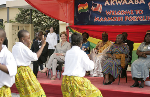 Mrs. Laura Bush watches a children's dance performance during welcome ceremonies Wednesday, Feb. 20, 2008, at the Maamobi Polyclinic health facility in Accra, Ghana. White House photo by Shealah Craighead