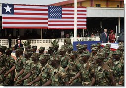 President George W. Bush and Liberian President Ellen Johnson Sirleaf review Liberian troops Thursday, Feb. 21, 2008, during President Bush's visit to the Barclay Training Center in Monvoria, Liberia. White House photo by Shealah Craighead