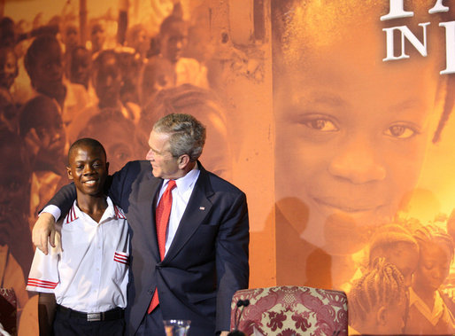 President George W. Bush embraces a student Thursday, Feb. 21, 2008, during an education roundtable at the University of Liberia in Monrovia, Liberia. White House photo by Eric Draper