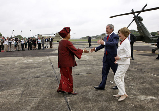 President George W. Bush and Mrs. Laura Bush are greeted by President Ellen Johnson Sirleaf of Liberia Thursday, Feb. 21, 2008, upon their arrival to the Spriggs Payne Airfield in Monrovia, Liberia. White House photo by Eric Draper