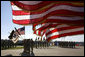 U.S. flags wave in the wind Tuesday, Feb. 26, 2008 during an Uncasing of the Colors Ceremony for the Third Corps at Fort Hood, Texas. White House photo by David Bohrer