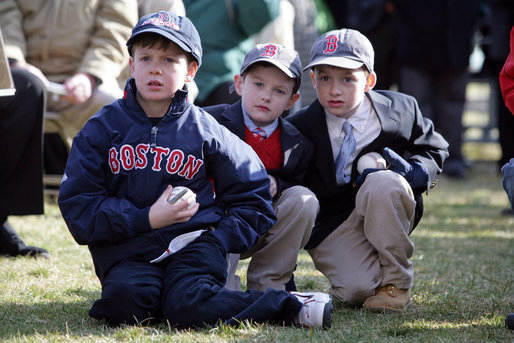 Young kids sit in awe wearing Boston Red Sox caps and holding baseballs hoping to get autographs during the Red Sox visit to the White House Wednesday, Feb. 27, 2008, on the South Lawn. White House photo by Chris Greenberg
