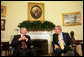 President George W. Bush meets with Jaap de Hoop Scheffer, Secretary General of the North Atlantic Treaty Organization (NATO) Friday, Feb. 29, 2008, in the Oval Office. White House photo by Chris Greenberg