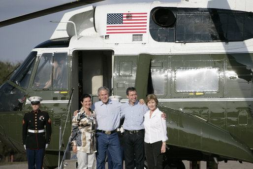 President George W. Bush and Mrs. Laura Bush are joined by Prime Minister Anders Fogh Rasmussen of Denmark and Mrs. Anne-Mette Rasmussen after the Danish first couple's arrival Friday, Feb. 29, 2008, to the Bush Ranch in Crawford, Texas. White House photo by Shealah Craighead