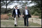 President George W. Bush and Prime Minister Anders Fogh Rasmussen of Denmark walk toward the cameras at the start of their press availability at The Bush Ranch in Crawford, Texas, Saturday, March 1, 2008, in Crawford, Texas. White House photo by Shealah Craighead
