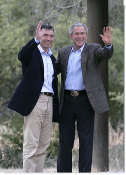 President George W. Bush and Prime Minister Anders Fogh Rasmussen of Denmark wave to the media at the conclusion of their press availability at The Bush Ranch in Crawford, Texas, Saturday, March 1, 2008, in Crawford, Texas. White House photo by Shealah Craighead