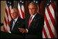 President George W. Bush stands with Attorney General Michael Mukasey as he addresses the National Association of Attorneys General at a drop-by briefing Monday, March 3, 2008, in the Eisenhower Executive Office Building. White House photo by Joyce N. Boghosian