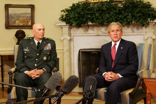 President George W. Bush speaks to reporters during a meeting with former Commanding General of Multi-National Corps-Iraq, Lieutenant General Ray Odierno, Monday March 3, 2008, in the Oval Office. President Bush has nominated General Odierno to Vice Chief of Staff of the Army and thanked him for his 30 months of service in Iraq. White House photo by Joyce N. Boghosian