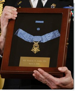A White House military aide holds the Medal of Honor presented posthumously to U.S. Army Master Sgt. Woodrow Wilson Keeble by President George W. Bush, Monday, March 3, 2008 in the East Room of the White House. Master Sgt. Keeble, the first full-blooded Sioux Indian to receive the Medal of Honor, was recognized for his gallantry above and beyond the call of duty during military action in the Korean War. White House photo by Eric Draper