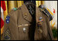 The Korean era U.S. Army jacket of Master Sgt. Woodrow Wilson Keeble is seen Monday, March 3, 2008, displayed in the East Room of the White House, during the presentation of the Medal of Honor, posthumously, in honor of Master Sgt. Keeble's gallantry during his service in the Korean War. Keeble is the first full-blooded Sioux Indian to receive the Medal of Honor. White House photo by Eric Draper