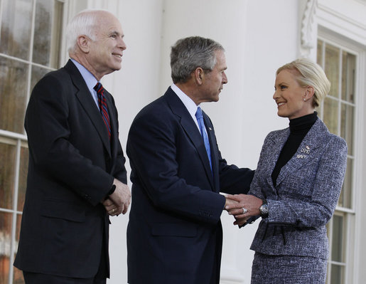 As her husband, Senator John McCain, looks on, President George W. Bush greets Cindy McCain after arriving Wednesday, March 5, 2008, at the White House, where the President offered his endorsement of the Republican presidential nominee. White House photo by Eric Draper