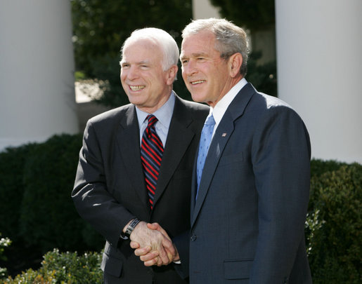 "President George W. Bush and Senator John McCain (R-Ariz.) shake hands as they deliver a statement Wednesday, March 5, 2008, in the Rose Garden of the White House. Said the President in his endorsement of Senator McCain, ""John showed incredible courage and strength of character and perseverance in order to get to this moment. And that's exactly what we need in a President."" White House photo by Chris Greenberg"
