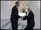 President George W. Bush shakes hands with Senator John McCain (R-Ariz.) as he arrived Wednesday, March 5, 2008, at the North Portico of the White House with his wife, Cindy. White House photo by Eric Draper