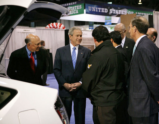 President George W. Bush stops to talk to the manufacturers of a converted plug-in hybrid electric vehicle during his tour of the Washington International Renewable Energy Conference 2008 Wednesday, March 5, 2008, at the Washington Convention Center in Washington, D.C. White House photo by Chris Greenberg