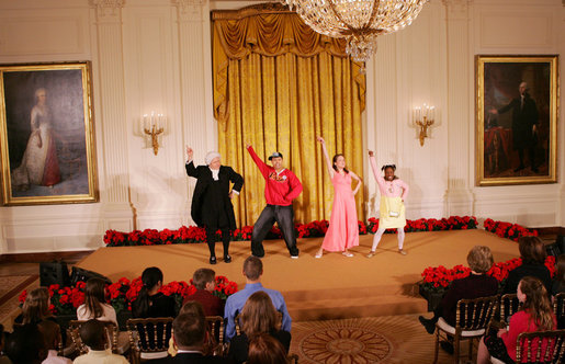 Mrs. Laura Bush, along with invited guests, watches a scene performance Friday, March 7, 2008 in the East Room of the White House, from the theater production of Chasing George Washington: A White House Adventure. The play is part of the Kennedy Center Performances for Young Audiences Series. White House photo by Joyce N. Boghosian