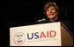 "Mrs. Laura Bush delivers remarks Friday, March 7, 2008, during the USAID Celebration of International Women's Day at the Ronald Reagan Building in Washington, D.C. Mrs. Bush told her audience, ""We're here today to tell our sisters around the world that we want them to join us. We're here to tell them that the long walk to freedom and equality, even though sometimes it might be a tiresome journey, that it's worth it. And the women of the United States are with them every single step of the way."" White House photo by Joyce N. Boghosian"