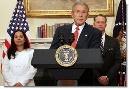 "President George W. Bush is joined by Cuban political activists Miguel Sigler Amaya and his wife, Josefa Lopez Pena as he delivers a statement Friday, March 7, 2008, on the state of Cuba. Said the President, ""As I told the Cuban people last October, a new day for Cuba will come. Until that day comes, the United States will continue to shine a bright and revealing light on Cuba's abuses. We will continue to tell the stories of Cuba's people, even when a lot of the world doesn't want to hear them. And we will carry this refrain in our hearts: Viva Cuba Libre."" White House photo by Chris Greenberg"