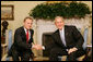 President George W. Bush welcomes Poland's Prime Minister Donald Tusk to the Oval Office of the White House, Monday, March 10, 2008. White House photo by Joyce N. Boghosian
