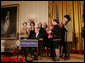 President George W. Bush is applauded by Mrs. Laura Bush, Cabinet members and members of Congress, at the proclamation signing for Women's History Month Monday, March 10, 2008 in the East Room of the White House in honor of Women's History Month and International Women's Day. From left are, U.S. Secretary of Labor Elaine Chao, U.S. Secretary of Transportation Mary Peters; New York Rep. Carolyn Mahoney, Rep. Marsha Blackburn of Tennessee, Rep. Judy Biggert of Illinois, Rep. Mary Fallin of Oklahoma, Rep. Shelley Moore Capito of West Virginia, Rep. Dianne Watson of California and Rep. Jean Schmidt of Ohio. White House photo by Joyce N. Boghosian