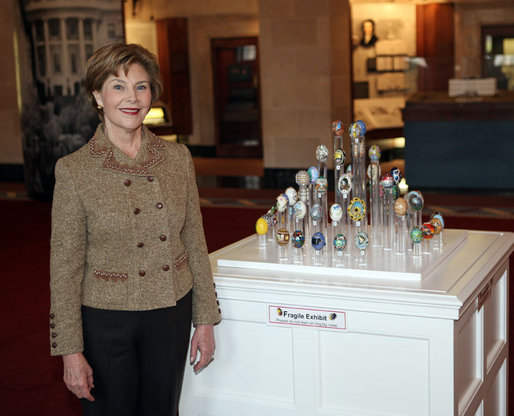 Mrs. Laura Bush poses with the 2008 State Easter Egg Display Monday, March 10, 2008, at the White House Visitors Center in Washington, D.C. The State Egg Display tradition has been going on since 1994, and is coordinated by the American Egg Board who selects an artist from each state to paint/decorate an egg. White House photo by Shealah Craighead