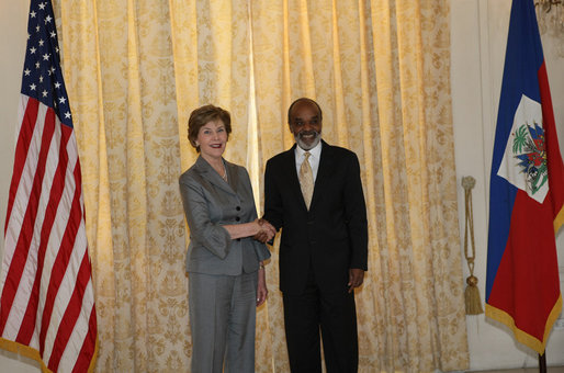 Mrs. Laura Bush meets with Haiti's President Rene Preval Thursday, March 13, 2008 at the National Palace in Port-au-Prince, Haiti, prior to Mrs. Bush's visit to the GHESKIO HIV/AIDS Center, the U.S. Embassy and the College de St. Martin Tours education program. White House photo by Shealah Craighead