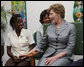 Mrs. Laura Bush speaks with a clinic patient and at risk adolescents during her visit Thursday, March 13, 2008 at the GHESKIO HIV/AIDS Center in Port-au-Prince, Haiti. GHESKIO is a participant in the President's Emergency Plan for AIDS Relief (PEPFAR), which has contributed approximately $365 million to fight HIV/AIDS in Haiti. White House photo by Shealah Craighead