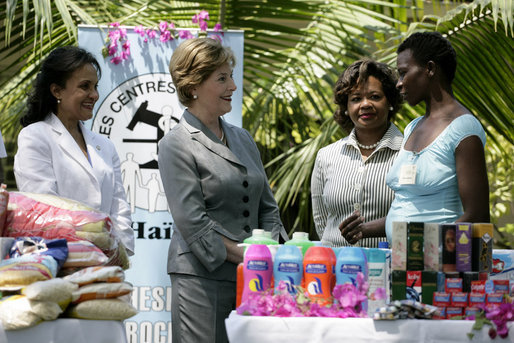Mrs. Laura Bush is introduced to a participant in the micro-credit program developed at the GHESKIO HIV/AIDS Center's women's clinic, Thursday, March 13, 2008, in Port-au-Prince, Haiti. The program was initiated to help improve the lives of HIV patients. White House photo by Shealah Craighead