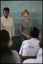 "Mrs. Laura Bush visits students enrolled in the IDEJEN educational program at the College de St. Martin Tours Thursday, March 13, 2008, in Port-au-Prince, Haiti. Speaking to the program's faculty and staff Mrs. Bush said, ""Educating its young people is one of the best things a country can do to ensure its continued development."" White House photo by Shealah Craighead"