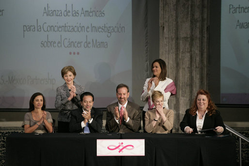 Mrs. Laura Bush applauds following the signing of the U.S.-Mexico Partnership for Breast Cancer Awareness and Research agreement between the Susan G. Komen for the Cure, MD Anderson Cancer Center, U.S. State Department, the Instituto Nacional de Cancerologia and Mexican Association Against Breast Cancer (Fundacion Cim*ab) Friday, March 14, 2008, at the Interactive Economics Museum in Mexico City. From left are Bertha Aguilar, Dr. Alejandro Mohar, U.S Ambassador to Mexico Antonio O. Garza, Jr., Hala Moddelmog, Margarita Zavala (standing), and Dr. Kendra Woods. White House photo by Shealah Craighead