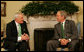 President George W. Bush welcomes Prime Minister Bertie Ahern of Ireland to the White House Monday, March 17, 2008, in celebration of St. Patrick's Day. White House photo by Joyce N. Boghosian