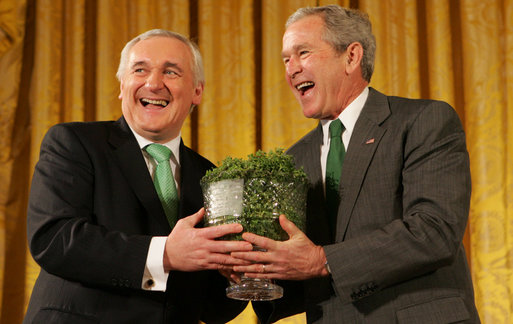 President George W. Bush breaks out in laughter as he's presented a bowl of shamrocks from Prime Minister Bertie Ahern of Ireland during a reception Monday, March 17, 2008, in celebration of St. Patrick's Day. White House photo by Joyce N. Boghosian