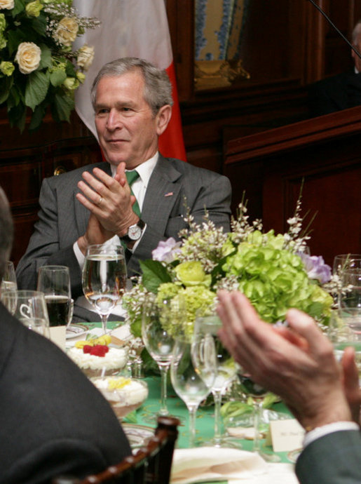 President George W. Bush applauds the music entertainment at the Speaker of the House's annual St. Patrick's Day luncheon Monday, March 17, 2008 at the U.S. Capitol in Washington, D.C. White House photo by Chris Greenberg