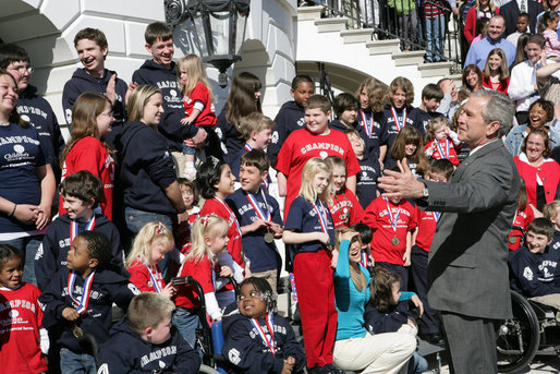 President George W. Bush gestures as he welcomes children and their parents from the Children's Miracle Network Champion Children to the White House Monday, March 17, 2008. White House photo by Chris Greenberg