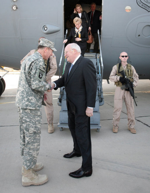 Vice President Dick Cheney is greeted by General David Petraeus, Commanding General of Multi-National Forces Iraq, as his wife Mrs. Lynne Cheney and daughter Liz Cheney deplanes in Baghdad, Monday, March 17, 2008. The visit is the Vice President's third to Iraq and comes during the fifth anniversary of the beginning of the U.S.-led campaign to liberate the Iraqi people. White House photo by David Bohrer