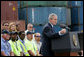 President George W. Bush, joined on stage by port workers, delivers remarks on U.S. trade policy Tuesday, March 18, 2008, at the Blount Island Marine Terminal in Jacksonville, Fla. White House photo by Chris Greenberg