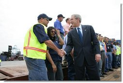 President George W. Bush meets and speaks with port workers following his remarks on U.S. trade policy Tuesday, March 18, 2008, at the Blount Island Marine Terminal in Jacksonville, Fla. White House photo by Chris Greenberg